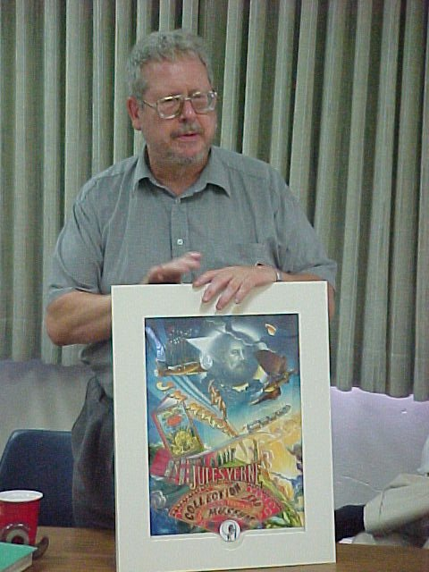 019_JMM.jpg - Jean-Michel shows us a poster that Roger has created for the Margot Collection.
