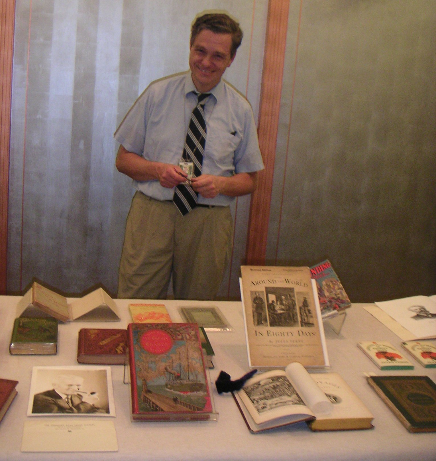 RareBooks1.jpg - Clark Evans of the Library's Rare Books collection shows some of their Verne Holdings.