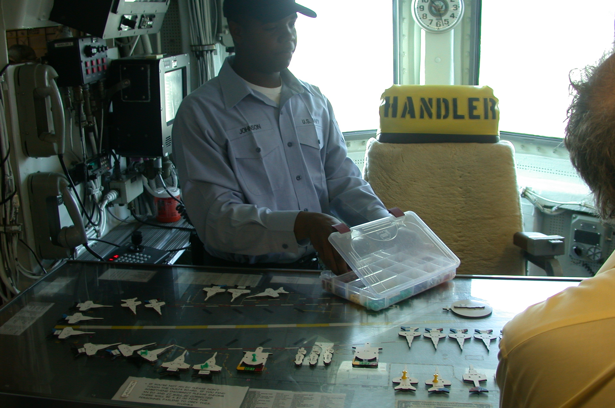 DSCN0085.jpg - One of the ship's crew tells us how they manage the aircraft on board ship.